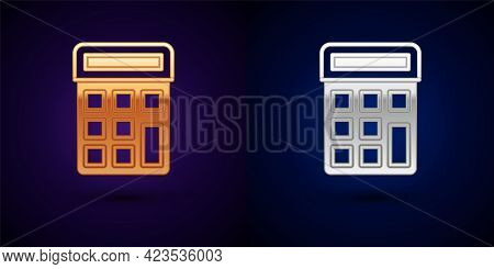 Gold And Silver Calculator Icon Isolated On Black Background. Accounting Symbol. Business Calculatio