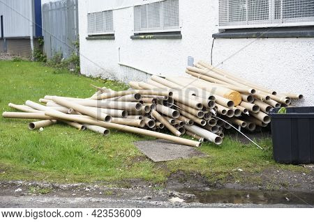 Cardboard Tubes And Rubbish Dumped Outside Building