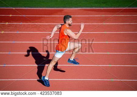 Challenge And Competition. Marathon Speed. Sprinter. Energetic Man On Running Track.