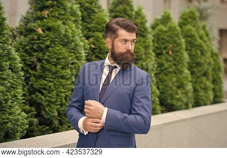 A Fashion Destination. Confident And Handsome. Serious Bride Groom Fixing Cuffs. Brutal Male Beauty.