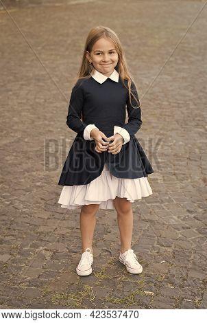 Find Your Inner Diva. Happy Child Wear Uniform Outdoors. Fashion Look Of Little Schoolgirl. Formal E