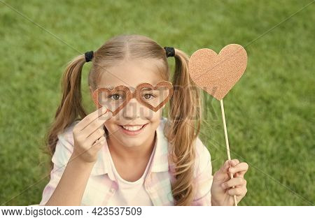 Love These Fun Valentine Props. Valentines Girl Hold Photo Booth Props. Party Look Of Happy Child. V