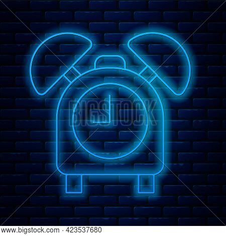 Glowing Neon Line Alarm Clock Icon Isolated On Brick Wall Background. Wake Up, Get Up Concept. Time