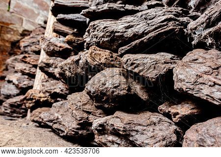Storage Of Dry Wooden Coal, Charcoal Is Piled And Ready For Ussage.