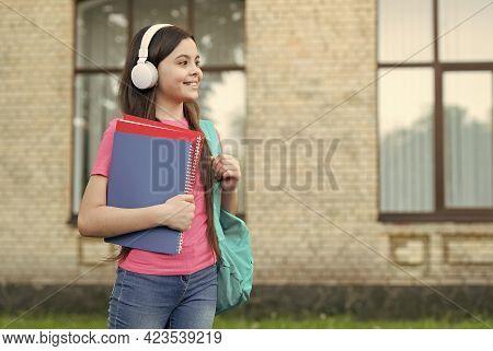Primary Modern School. Happy Girl Wear Headphones Outdoors. Modern Life. Little Child Listen To Mode