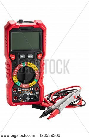 Upright View Of Red Portable Digital Multimeters Or Multitester With Test Leads And Probes Isolated