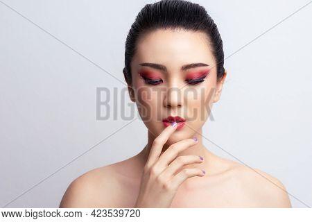 Makeup Asian Woman Close Eyes Show Colorful Eyeshadow With Extreme Long False Eyelashes. Eyelash Ext