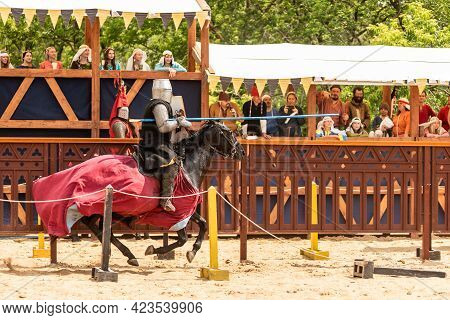 Moscow, Russia, June 8, 2019 - Equestrian Knight Participates In A Knightly Tournament. Knight On Ho