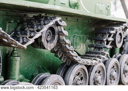 Fragment Of A Tracked Track On Green Camouflage Tank.