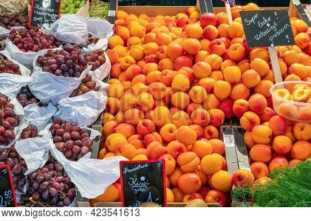 Mirabelle Plums And Grapes For Sale At A Market