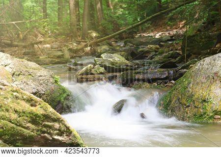 Silky Effect Of Small Waterfall In A Brook At Resovske Vodopady Park. Czech Republic.