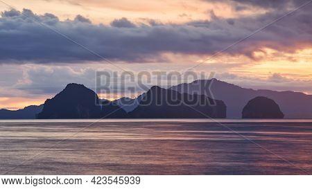 Silhouettes Of Tropical Islands At Colorful Sunrise. Beautiful Seascape Near Krabi, Thailand.