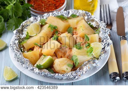 Cajun Pineapple Chicken, Baked In A Foil Packet, Garnished With Lime And Cilantro, Horizontal