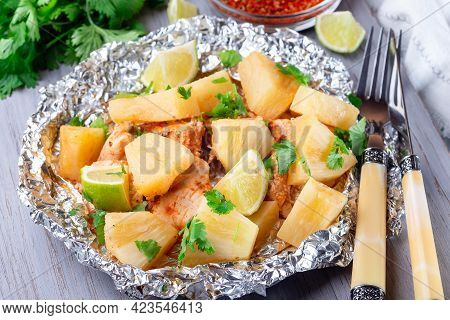 Cajun Pineapple Chicken, Baked In A Foil Packet, Garnished With Lime And Cilantro, Horizontal, Close