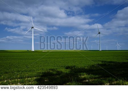 Offshore Windmill Park With Clouds And A Blue Sky, Windmill Park In The Ocean Aerial View With Wind