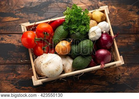 Fresh Vegetables In Wooden Box On Rustic Table