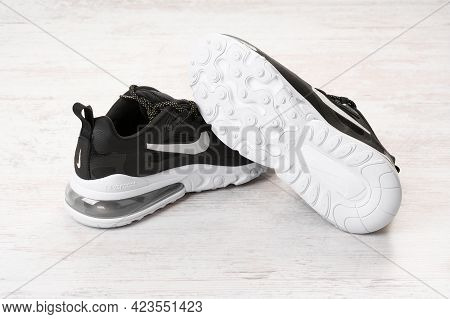 Burgas, Bulgaria - December 8, 2020: Nike Air Max 270 React Women's Shoes - Sneakers In Black On Whi