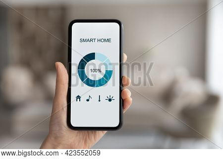 Close Up Of Woman Use Cellphone With Smarthome Application