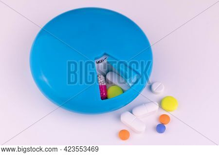 Pill Box With Days Of The Week Medication Reminder Concept Close-up