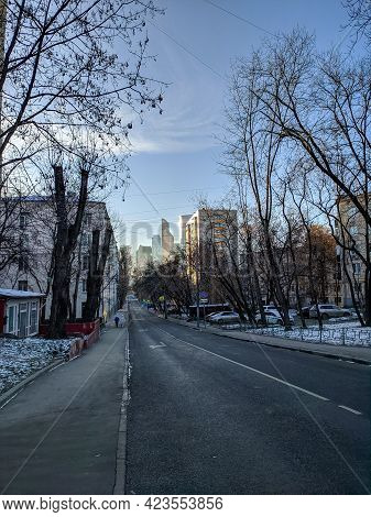 Winter Moscow Street Leading To Moscow City. People Walk Along The Sidewalk In Good Clear Weather An