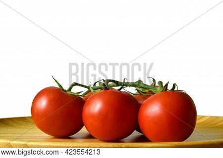 Ripe Tomato Plant In Wooden Plate On White Background. Tasty Red Heirloom Tomatoes. Close-up, Copy S
