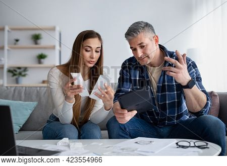 Mature Married Couple Having Financial Problems, No Money To Pay Their Bills, Discussing Income, Goi