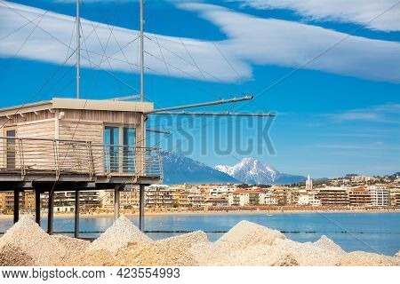 Trabucco At Porto, Overlooking The Pescara Seafront, With The Bell Tower Of The Divino Amore Church