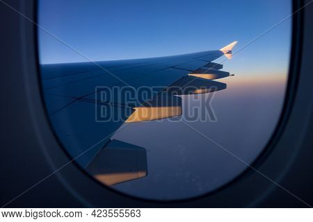 Close-up Shot Of The Aircraft Wing Of An Airbus A380 Super Jumbo From The Window.