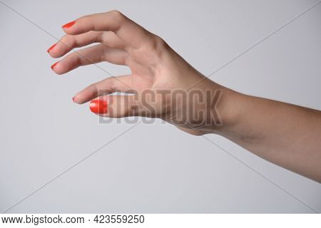Hand Of A Girl Trying To Reach Or Grab Something. Fling, Touch Sign. Isolated On White Background.