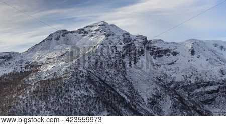 A Breathtaking Shot Of The Ancares Mountains Covered With Snow Glimmering Under The Blue Sky - Great
