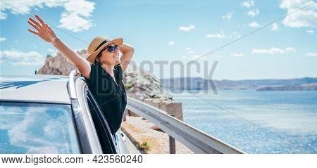 Cheerful Woman Portrait Enjoying The Seaside Road Trip. Dressed A Black Dress, Straw Hat And Sunglla