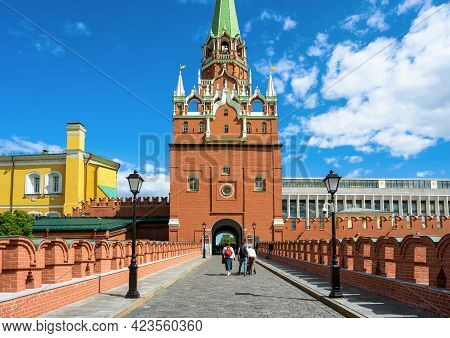 Moscow Kremlin Entrance For Tourists, Moscow, Russia. People Walk On Fortress Bridge To Troitskaya T