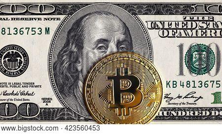 Bitcoin Vs Us Dollar, Gold Bit Coins On 100 Dollar Bill. Digital Crypto Currency Bitcoin And Frankli