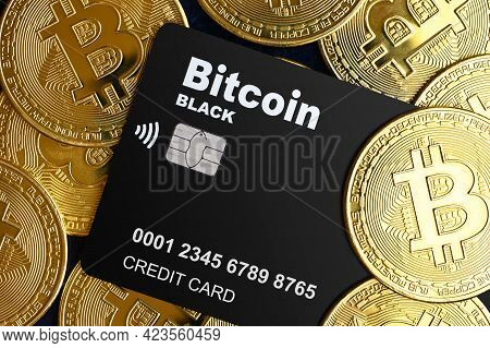 Bitcoin Credit Card And Pile Of Bit Coins, Digital Crypto Currency Bitcoin For Electronic Transactio