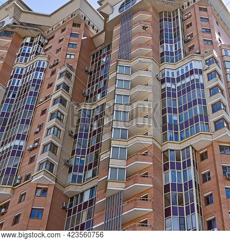 Facade Of A High-rise Apartment Building. Typical City Development. Multi-storey Residential Buildin