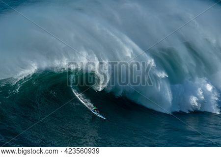Nazaré, Portugal - Dec 01, 2019: The Tall Foamy Waves Of The Atlantic Ocean Near The Nazare Municipa