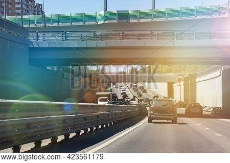Road Scenery On A Highway At Summer Time. A Toned Image Of A Cityscape. Car Traffic On The Road In M