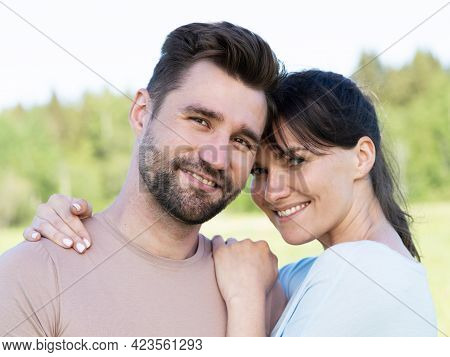 Portrait Of A Smiling Mid Adult Couple In Summer Park