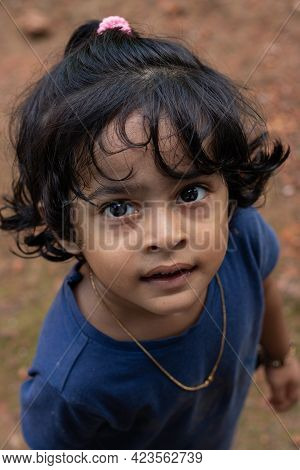 Closeup Of A Cute Little Girl With A Curious Look On Her Face
