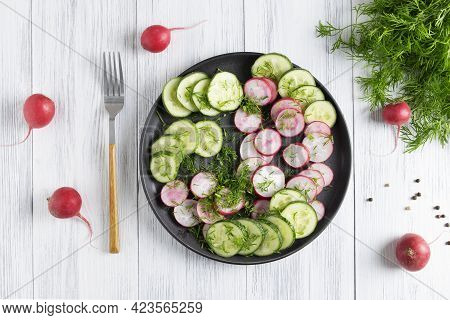 Top View Of Fresh Cucumber And Radish Salad With Dill And Vegetable Oil. Vegetarian Diet. Diesta For