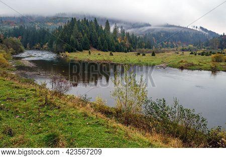 Foggy And Overcast Autumn Day In Carpathian Mountains. Rika River Bend, Transcarpathia, Ukraine.