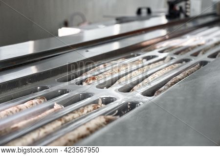 Sausages. Packing Line Of Sausages. Industrial Manufacture Of Sausage Products. High Quality Photo.