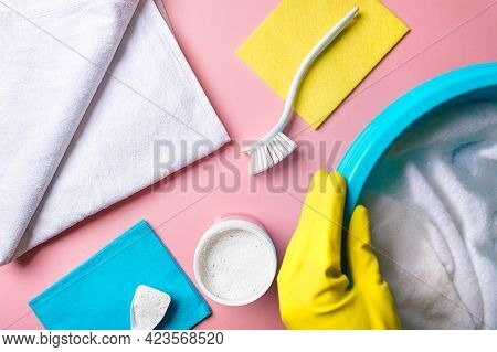 House Cleaning Product And Bucket, Pail Or Container With Foam On Pink Background. Flat Lay Or Top V