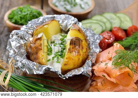 Baked Jacket Potato Fresh From The Oven Served With Chives Sour Cream And Smoked Salmon