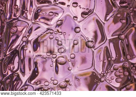 Sparkling Water Bubbles In A Pink Hard Plastic Tumbler. Abstract Macro Shot With Irregular Water Dro