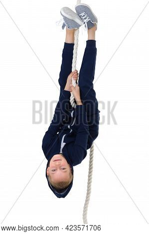 Active Boy Swing Upside Down On The Rope. Kid Playing And Having Fun Doing Activities. Happy Child W