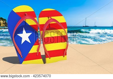 Flip Flops With Catalan Flag On The Beach. Catalonia Resorts, Vacation, Tours, Travel Packages Conce