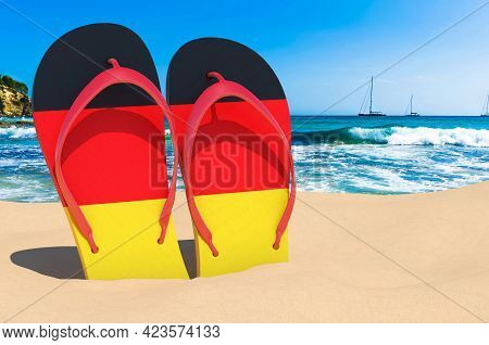 Flip Flops With German Flag On The Beach. Germany Resorts, Vacation, Tours, Travel Packages Concept.