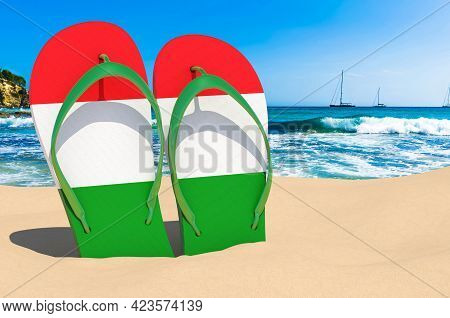 Flip Flops With Hungarian Flag On The Beach. Hungary Resorts, Vacation, Tours, Travel Packages Conce