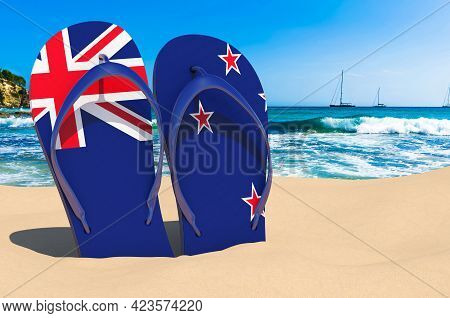 Flip Flops With New Zealand Flag On The Beach. New Zealand Resorts, Vacation, Tours, Travel Packages